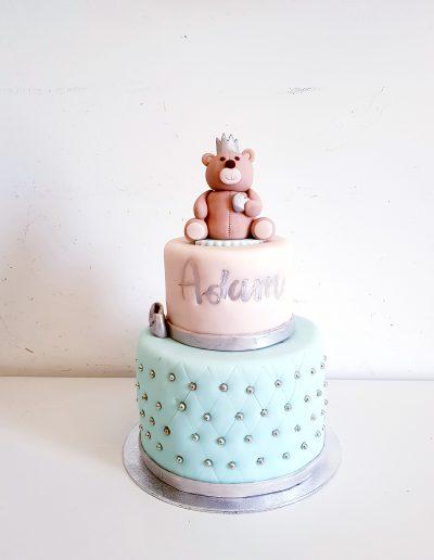 Gâteau d'anniversaire pour adam rose et bleu