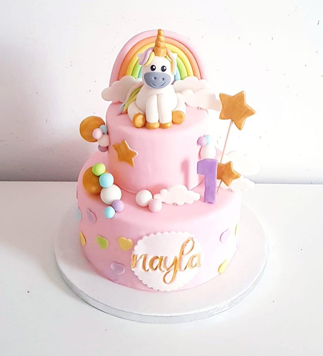 Superbe gâteau pour un anniversaire enfant rose poney